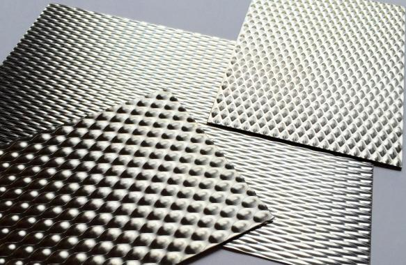 Embossed sheets for packaging system